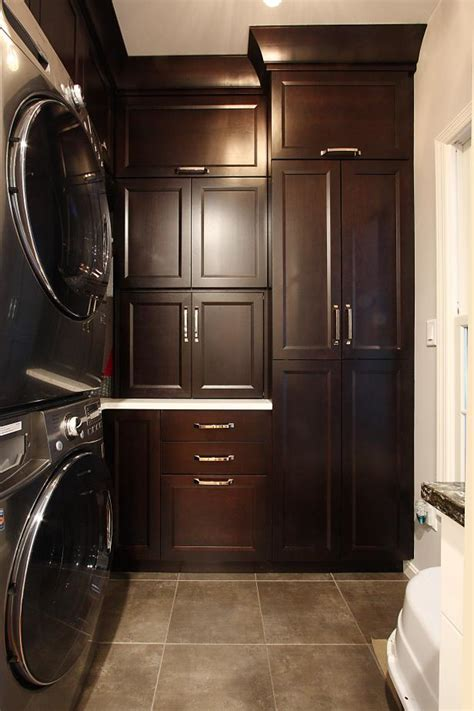 Traditional Laundry Room Design With Dark Wood Cabinets