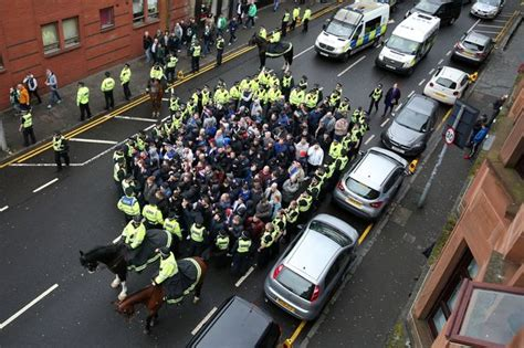 Police march Rangers fans to Parkhead ahead of Old Firm