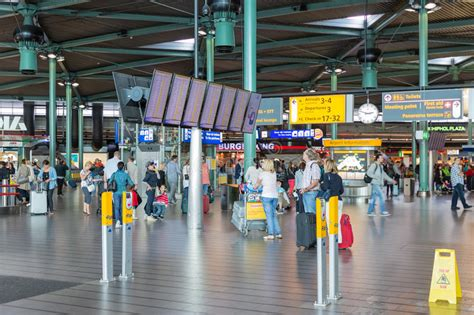 Central Hall Of Schiphol Airport With Travellers