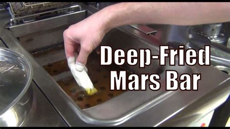 Eating a Deep-Fried Mars Bar along with a Battered