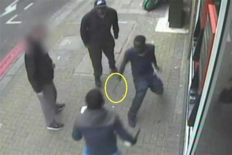 Police hunt two men after knife attack on Tooting High